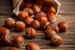 Close up of hazelnuts on the wooden texture