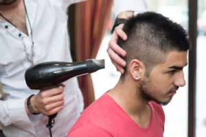 Stylist Drying Hair Of A Male Client