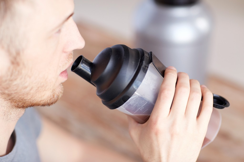 close up of man drinking protein shake